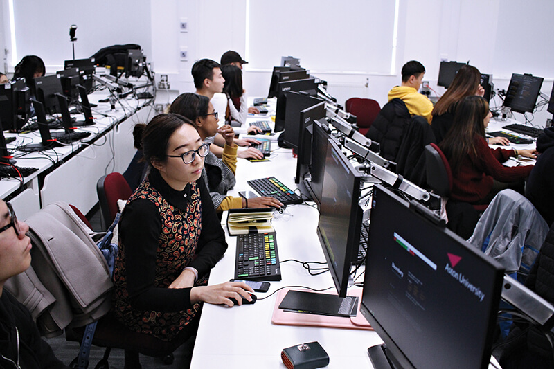 Students studying in a computer room