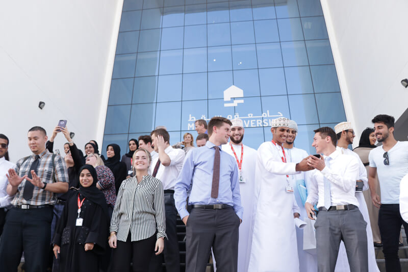 Students and staff outside Muscat University
